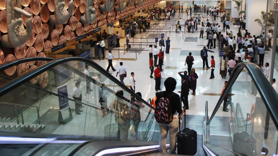 Passengers arrive at Terminal 3 of the IGI Airport in New Delhi.