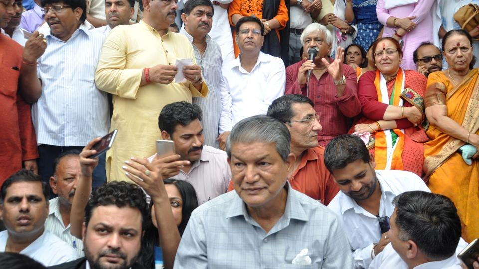 Congress leader Harish Rawat leads the party's protest in Dehradun on Thursday.