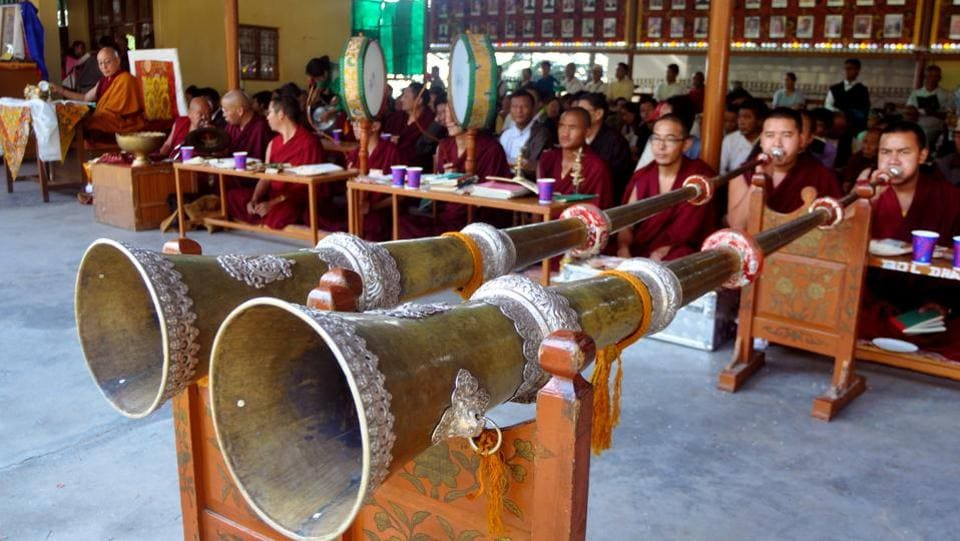 Exiled Tibetan Buddhist monks blow ceremonial horns during a special morning-prayer session on the occasion of 82nd birthday of Dalai Lama at a monastery in Mcleodganj, near Dharamsala on Thursday.  (Shyam Sharma/HT Photo)