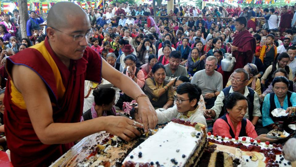 An exiled Tibetan Buddhist monk distributes birthday cake on the 82nd birthday of their spiritual leader the Dalai Lama in Mcleodganj, near Dharamsala on Thursday. (Shyam Sharma/HT Photo)