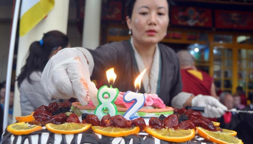 Tibetans living-in-exile in India celebrate 82nd birthday of their spiritual leader the Dalai Lama at Tsuglhakhang temple in McLeodganj, near Dharamsala, on Thursday.  (Shyam Sharma/HT Photo)