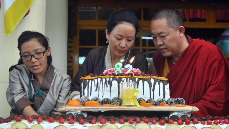 Born on July 6, 1935, at Taktser hamlet in northeastern Tibet, the Dalai Lama was recognised at the age of two as the reincarnation of the 13th Dalai Lama, Thubten Gyatso. Tibetans lcut a birthday cake as they celebrate the 82nd birthday of their spiritual leader the Dalai Lama at Tsuglhakhang temple at McLeodganj, near Dharamsala, on Thursday. (Shyam Sharma/HT Photo)