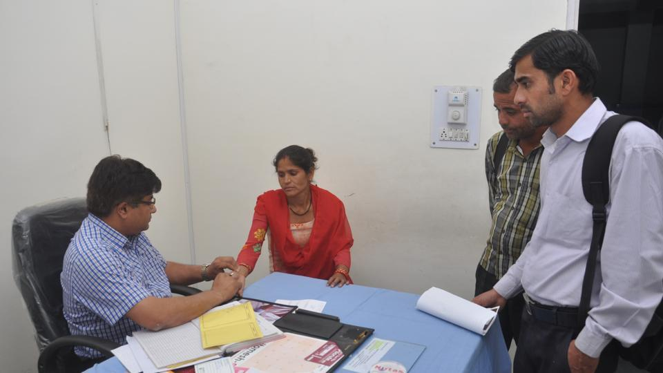 A doctor examining a patient at a Doon hospital.