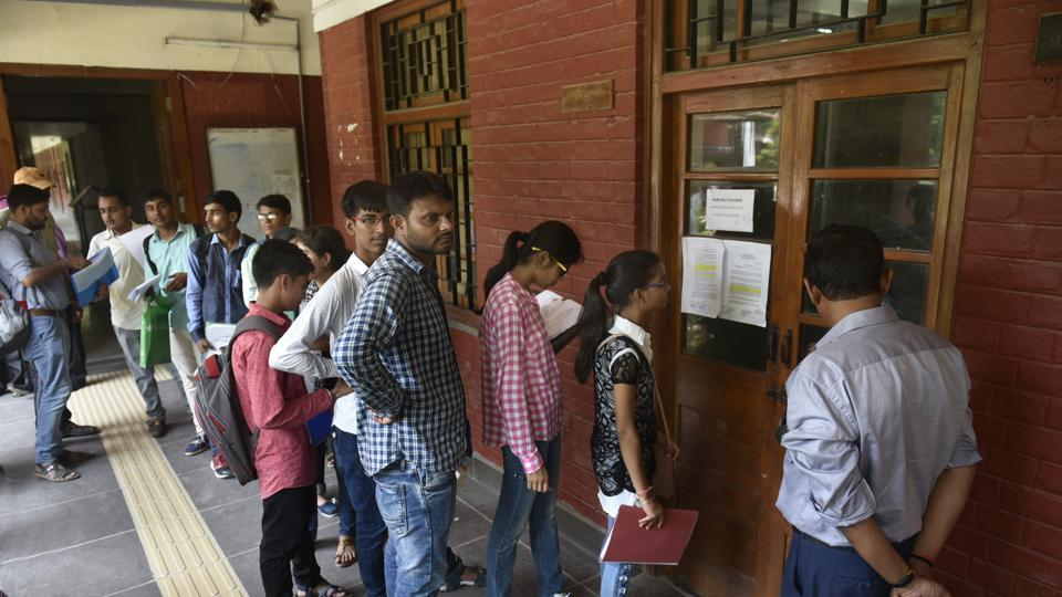 Students standing in a queue for the verification of their documents for the admission for the new academic year 2017-18, at Hans Raj College in North Campus in New Delhi.