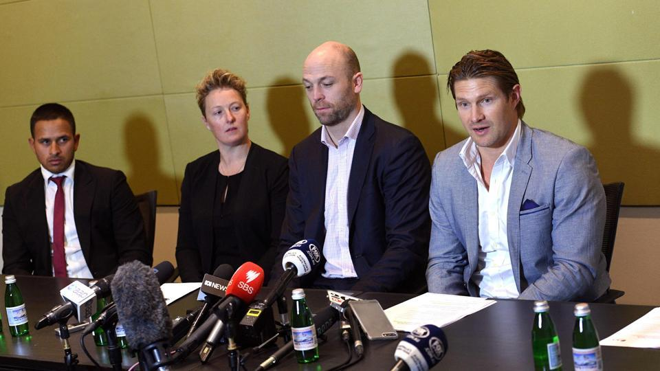Cricketers Usman Khawaja (L), Clea Smith (2/L), Shane Watson (R) and Australian Cricketers' Association (ACA) chief executive Alistair Nicholson (2/R) attend a press conference in Sydney on July 2, 2017. Australia A boycotted this month's tour to South Africa, escalating a bitter pay dispute which threatens to derail senior tours to Bangladesh and India as well as this year's home Ashes.