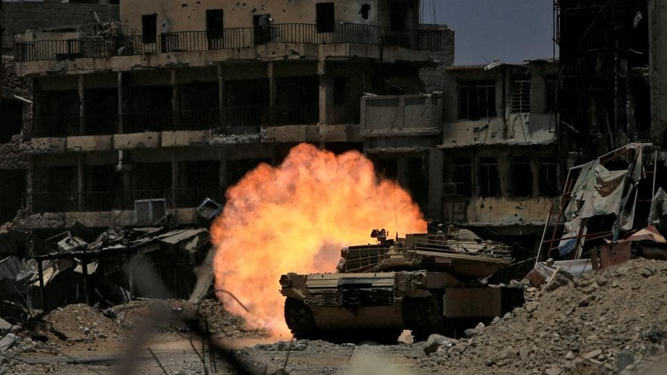 A tank of the Emergency Response Division fires at Islamic State militant in the old city of Mosul, Iraq July 5, 2017.