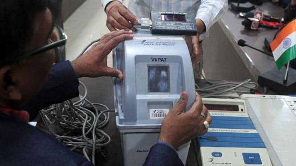 An Indian district administrative officer explains a Voters Verifiable Paper Audit Trail (VVPAT) machine during a press conference in Allahabad on February 6.
