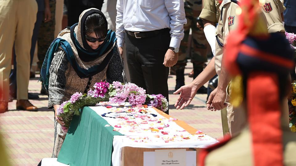 Chief minister of Jammu and Kashmir state Mehbooba Mufti lays a wreath on the coffin of police officer Mohammad Ayub Pandith during a ceremony in Srinagar on June 23.