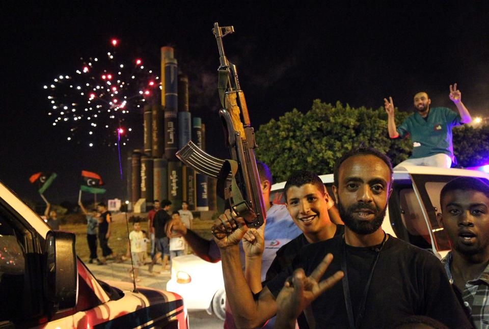 Libyans celebrate in Benghazi after strongman Khalifa Haftar announced the