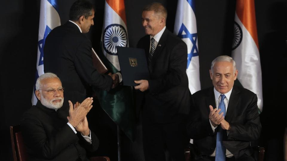 Indian Prime Minister Narendra Modi (L), sits with Israeli counterpart Benjamin Netanyahu during their meeting at the King David hotel in Jerusalem, where the two nations signed a series of agreements to cooperate in the fields of technology, water and agriculture with the establishment of a bilateral Technology Innovation Fund worth $40 million. (Sebastian Scheiner / AP)