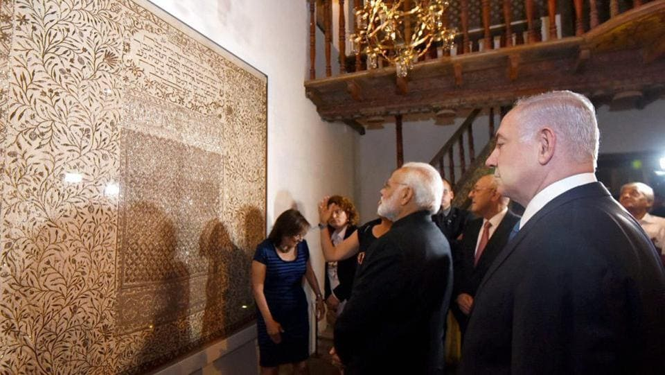 Narendra Modi and his counterpart from Israel Benjamin Netanyahu visit an exhibition on India-Jewish Heritage at Israeli museum in Jerusalem. According to a joint statement by India and Israel Prime Minister Modi announced the opening of an Indian Cultural Centre in Israel. Modi also presented Netanyahu replicas of copper plates from the 9th century, an ancient charter cherished by Cochin Jews. (PIB / PTI)
