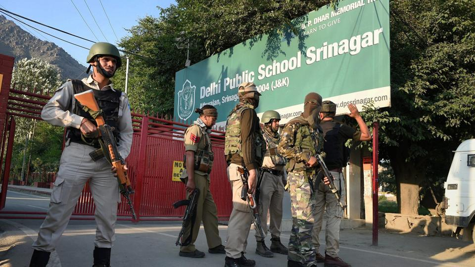 Special task force of police positioned outside a school during search operation in Srinagar.