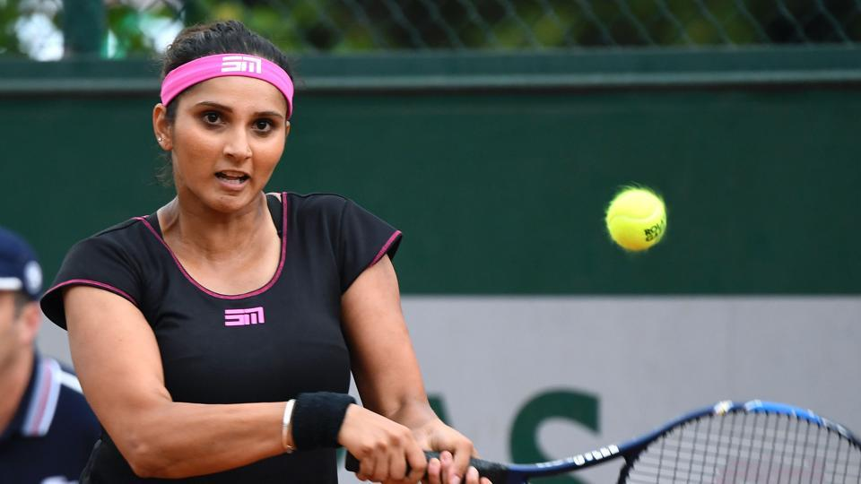 India's Sania Mirza comfortably won her Wimbledon women's doubles opener on Wednesday.