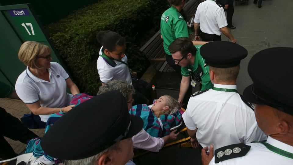 Bethanie Mattek-Sands is wheeled away on a stretcher after suffering an injury during her women's singles second round match at Wimbledon.