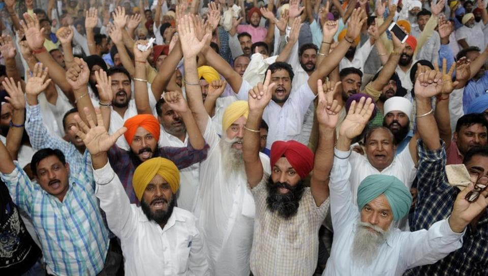 Members of All Punjab Truck operators union holding a protest against at New Grain market in Patiala on Thursday.