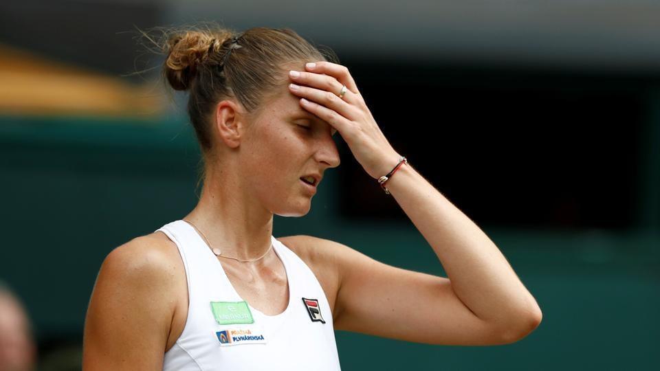 Czech Republic's Karolina Pliskova reacts during her Wimbledon second round match against Slovakia's Magdalena Rybarikova.