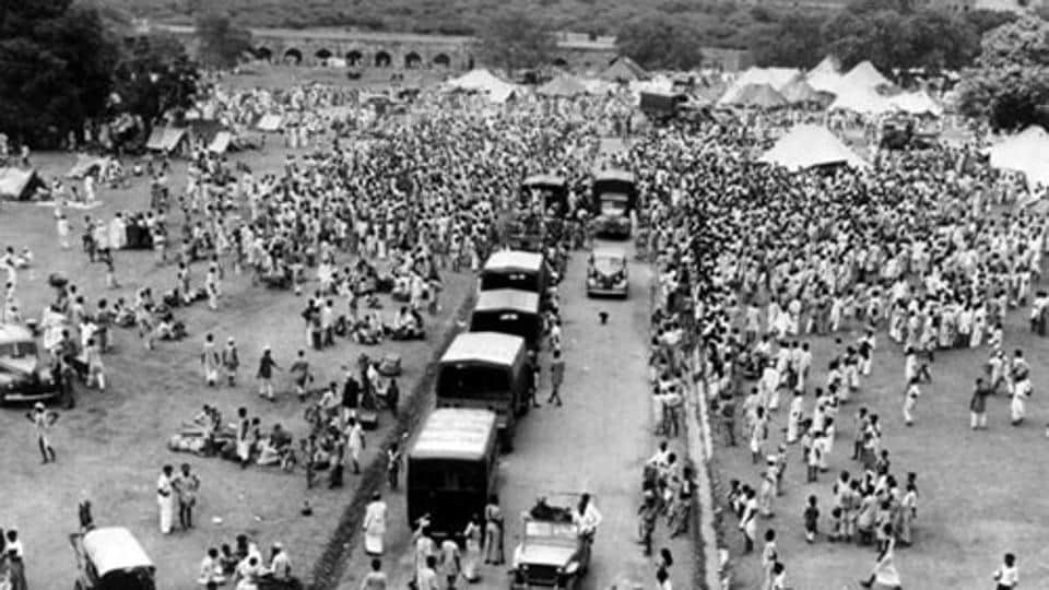 In September, 1947, Muslims gather as they as they seek protected transport to Pakistan