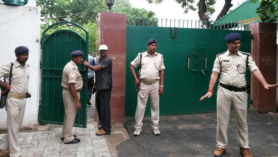 Police officials cordon off the entrance to Lalu Prasad's residence in Patna while the CBI conducts raids, on July 7, 2017.