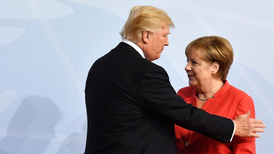 German Chancellor Angela Merkel greets US President Donald Trump at the start of the G20 meeting in Hamburg.  (AFP)