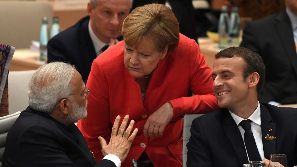 (L to R) Prime Minister Narendra Modi, German Chancellor Angela Merkel and French President Emmanuel Macron talk ahead a working session on the first day of the G20 summit in Hamburg, Germany, on Friday.