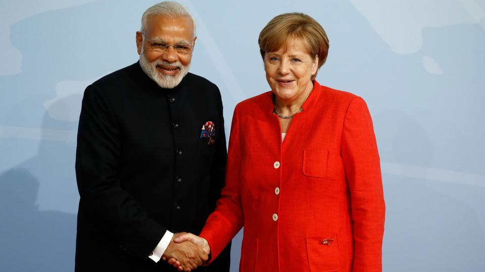 German Chancellor Angela Merkel welcomes Prime Minister Narendra Modi as he arrives to attend the G20 summit in Hamburg.