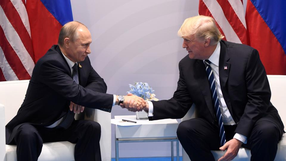 US President Donald Trump and Russia's President Vladimir Putin shake hands during a meeting on the sidelines of the G20 Summit in Hamburg, Germany.