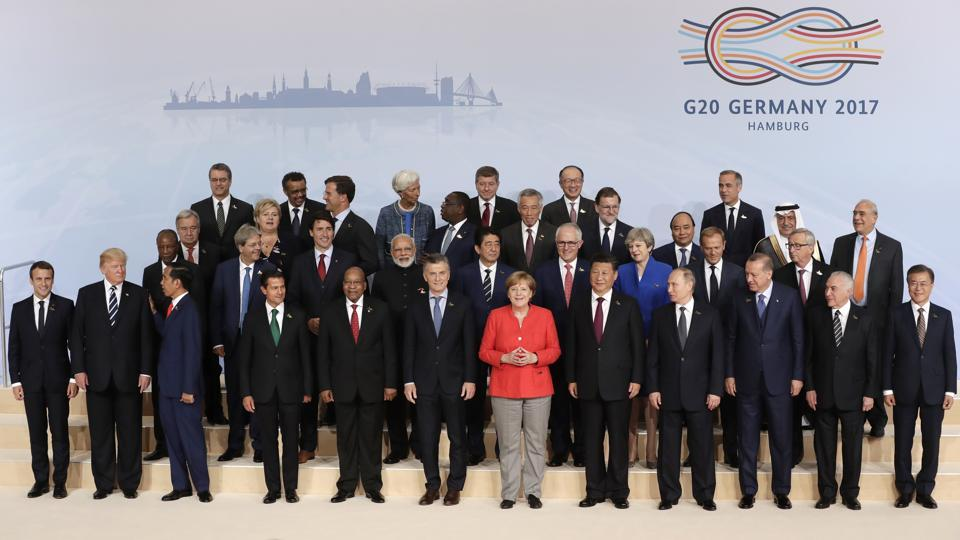 The participants pose for a group photo on the first day of the G-20 summit in Hamburg.  While host German Chancellor Angela Merkel welcomed the leaders to open the 12th G20 Summit, a separate meeting of BRICKS leaders took place on the sidelines.Fighting terrorism, climate change and global trade are expected to be the key areas of discussion at the two-day Summit, whose theme is 'Shaping an 'Inter- connected World' (AP)