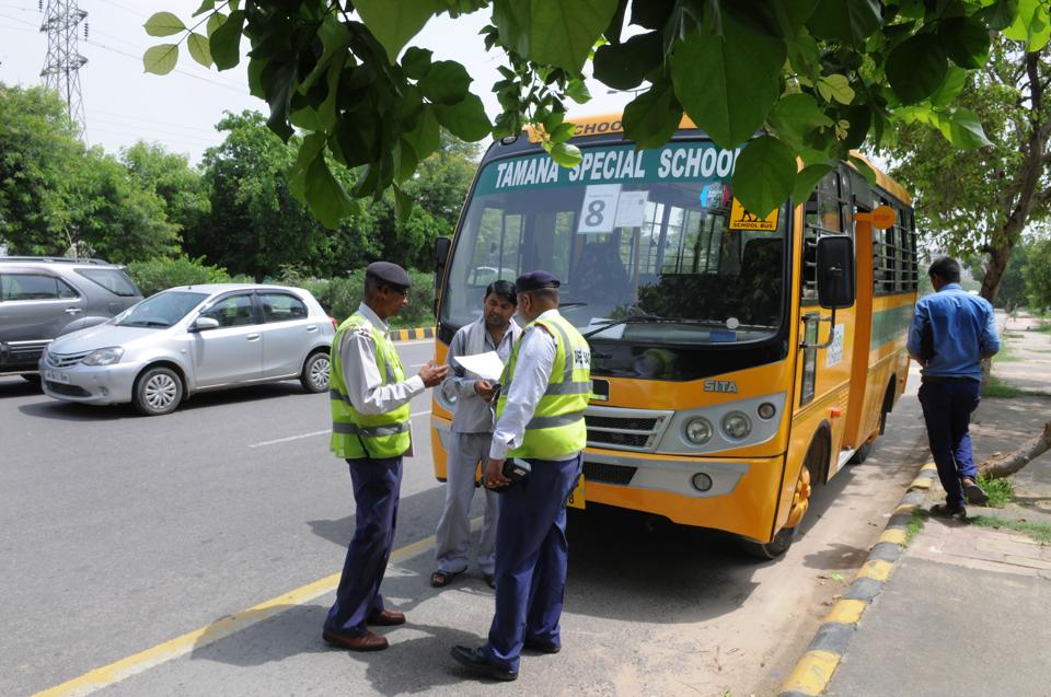 Gurgaon Traffic police checking the school bus papers during the campaign against school buses at sector-47 chowk.