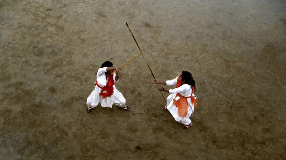 A Durga Vahini girls takes part in a self-defence training camp organised by Vishva Hindu Parishad (VHP) in Jammu.  Durga Vahini is the female counterpart of the Bajrang Dal, a subsidiary of the Hindu nationalist organisation Vishwa Hindu Parishad (VHP) which was established in 1991.  Women between the ages of 18 and 35 are allowed to join this camp and trained. (Nitin Kanotra /HT Photo)