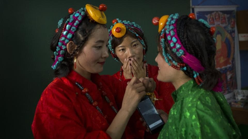 Exiled Tibetans women in their traditional dress prepare for a dance performance during celebrations marking the 82nd birthday of their spiritual leader the Dalai Lama at a Tibetan settlement in New Delhi, India. (AP)