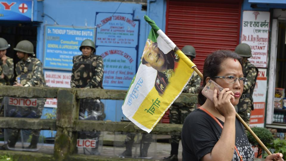 An Indian supporter of the separatist Gorkha Janamukti Morcha (GJM) carries a party flag during the 23th day of an indefinite strike called by GJM in Darjeeling on July 7, 2017. Eastern India's hill resort of Darjeeling has been rattled at the height of tourist season after violent clashes broke out between police and hundreds of protesters of the Gorkha Janmukti Morcha (GJM) -- a long-simmering separatist movement that has long called for a separate state for ethnic Gorkhas in West Bengal. (DIPTENDU DUTTA / AFP)