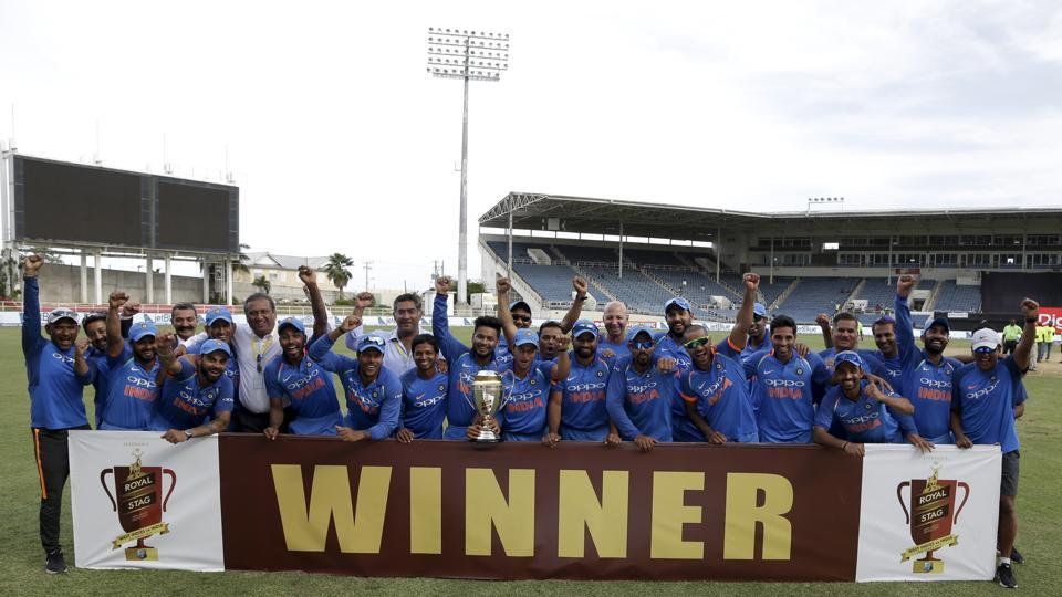 Indian cricket team players celebrate with the trophy after beating the West Indies 3-1 in the five-match One-Day International series at Sabina Park in Kingston on Thursday. (AP)