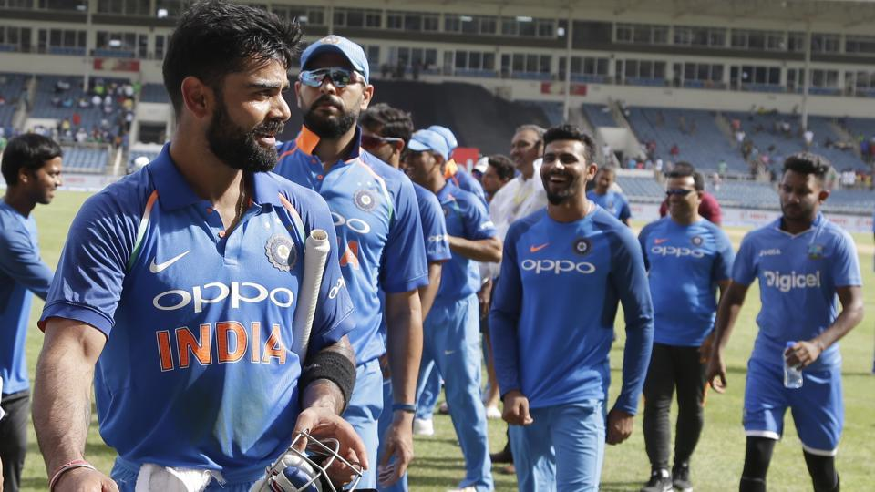 India captain Virat Kohli leads the team off the field after beating West Indies by 8 wickets during their fifth ODI at the Sabina Park cricket ground in Kingston, Jamaica on Thursday.