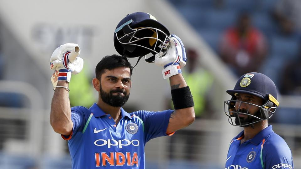 India's captain Virat Kohli celebrates after he scored a century against West Indies in his partnership with Dinesh Karthik, right, during their fifth ODI at the Sabina Park cricket ground in Kingston, Jamaica.