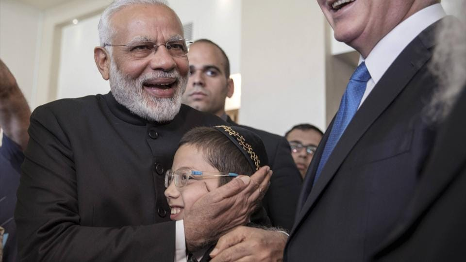 Indian Prime Minister Narendra Modi,left, with Israeli Prime Minister Benjamin Netanyahu,center right, meet with Moshe Holtzberg, center, an Israeli boy, whose parents were killed in the Nov. 26, 2008 terrorist attack on the Mumbai, Chabad House, in Jerusalem. (AP)