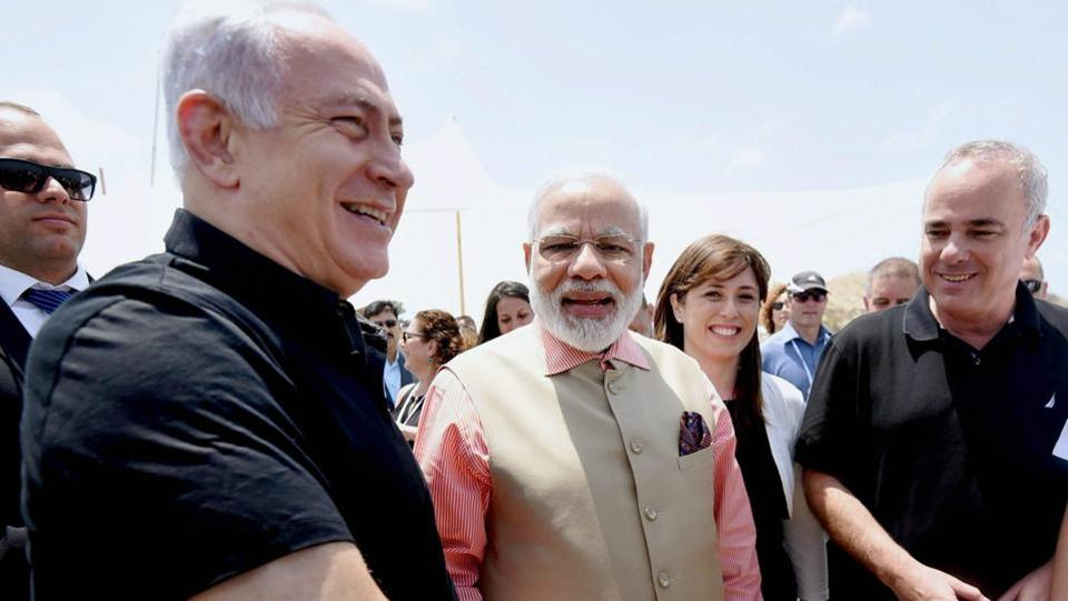 Prime Minister Narendra Modi shakes hands with his Israeli counterpart Benjamin Netanyahu during a visit to the Olga Beach in Israel . (PTI)