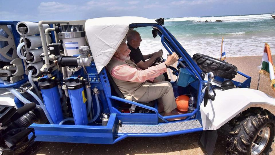 Modi and Netanyahu seen driving together in the mobile water desalination unit. (PTI)