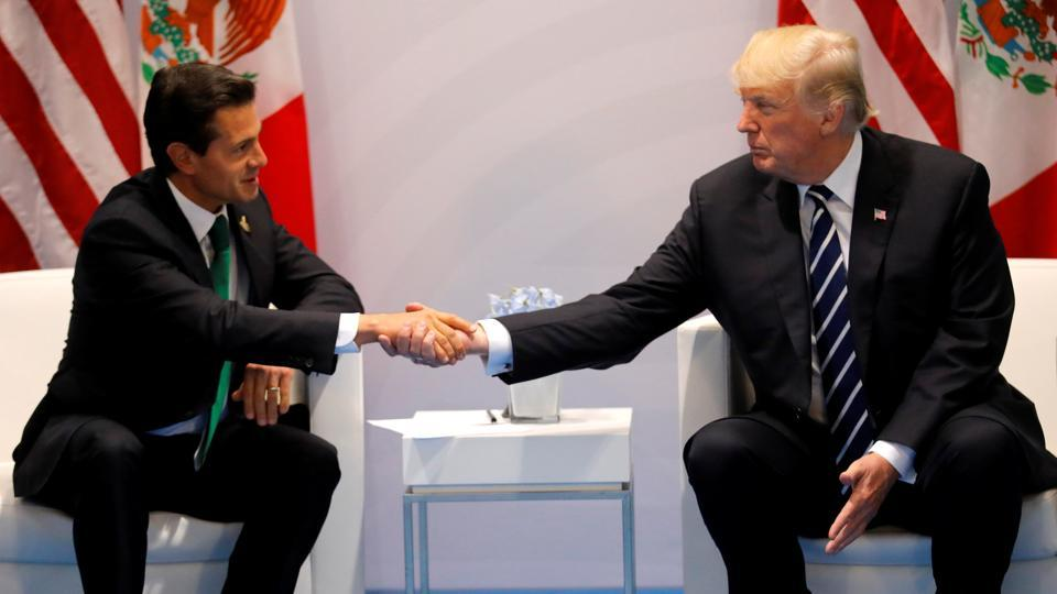US President Donald Trump shakes hands with Mexico's President Enrique Pena Nieto.