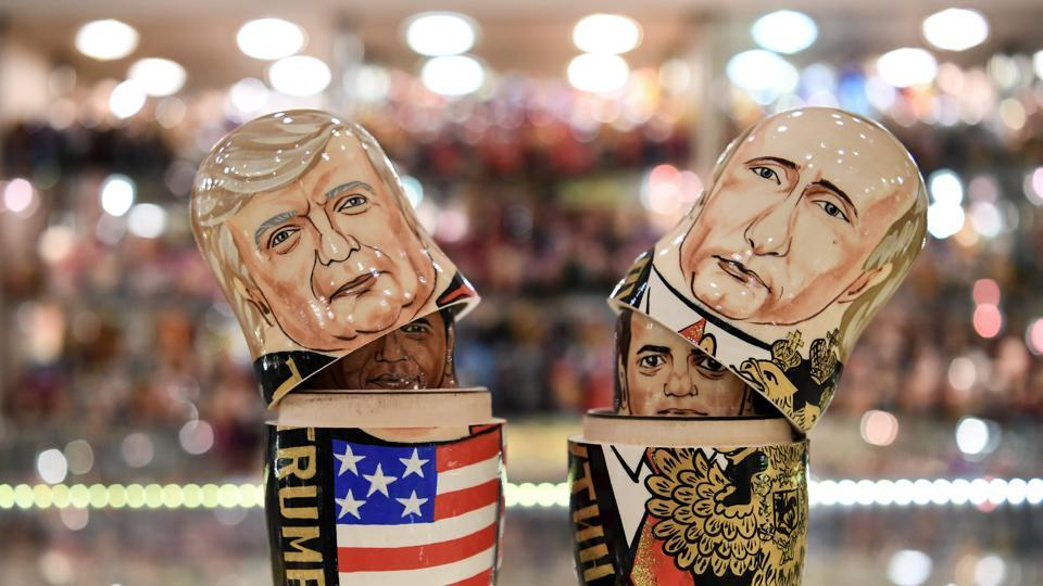 Traditional Russian Matryoshka dolls, depicting US President Donald Trump (L) and Russia's President Vladimir Putin (R) at a gift shop in central Moscow. US president Donald Trump is due to meet his Russian counterpart Vladimir Putin on July 7, 2017 during the G20 summit in Germany