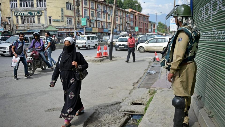 A security personnel stands guard in Srinagar on Thursday, as authorities beefed up security in the Kashmir Valley ahead of the first death anniversary of Hizbul Mujahideen commander Burhan Wani.