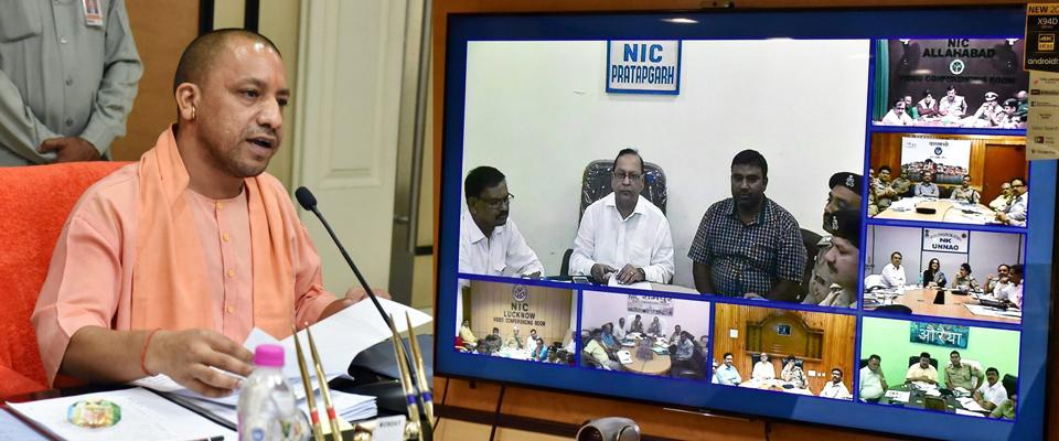 Uttar Pradesh chief minister Yogi Adityanath interacting with senior district and police official through video-conferencing in Lucknow on Thursday.
