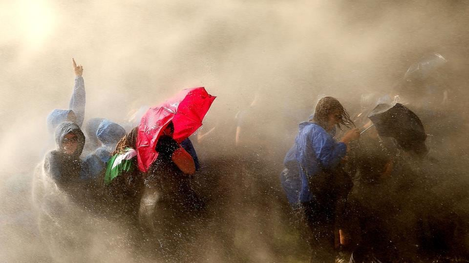 Demonstrators are hit by water cannons of the police as they protest against the ongoing G20 summit.  (AFP)
