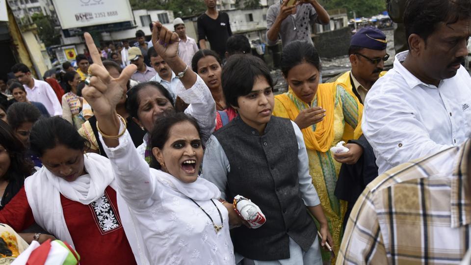 Trupti Desai (in black waist coat) protests outside the Haji Ali Dargah in Mumbai on August 28, 2016.