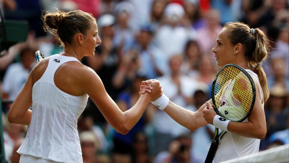 Slovakia's Magdalena Rybarikova (R) shakes hands with Czech Republic's Karolina Pliskova after winning their second round match.