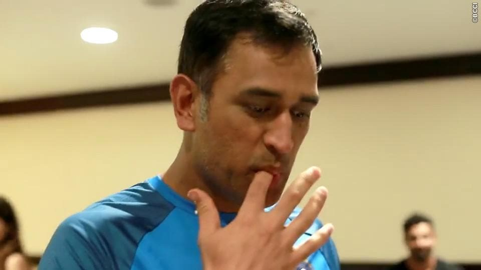 Birthday boy MS Dhoni gets a taste of his cake before cutting it.  (BCCI)