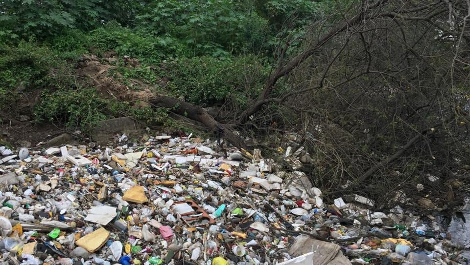 The body was found floating face down amid thick layer of garbage in a canal that runs along the Camp Education Society's Kanya Shala.