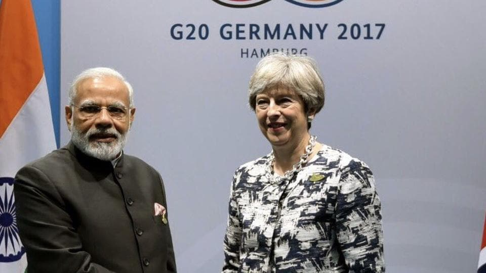 Prime Minister Narendra Modi (L) with UK counterpart Theresa May in Hamburg, Germany, on Saturday.