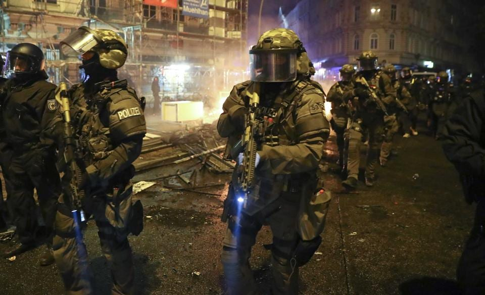 Members of the German special police force walk through the Schanze district following clashes with anti-G20 protesters in Hamburg on July 8, 2017.