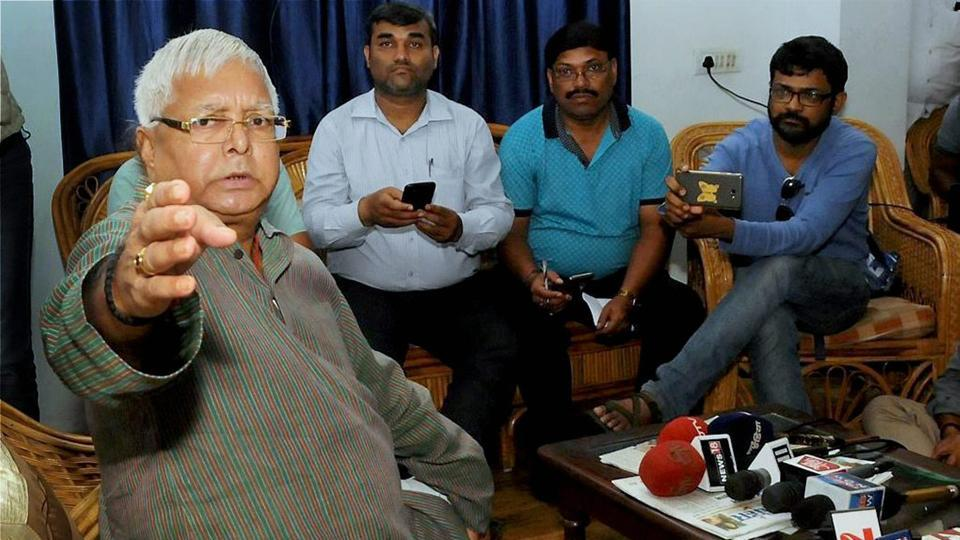 RJD chief Lalu Prasad addresses the media in Ranchi after the CBI conducted raids at his residences.