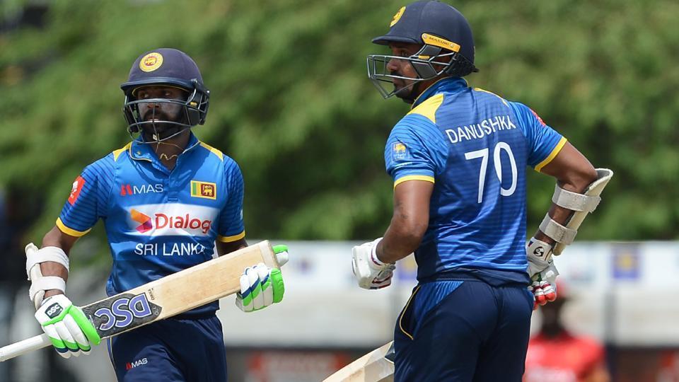 Niroshan Dikwella (L) and teammate Danushka Gunathilaka run between the wickets during the fourth one-day international (ODI) cricket match between Sri Lanka and Zimbabwe in Hambantota on Saturday.